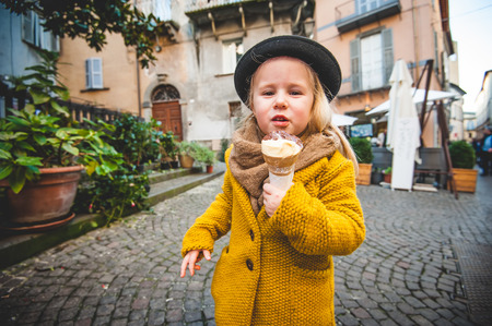Little girl eaten ice cream photo