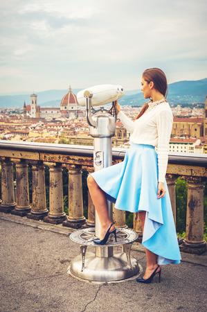 impressed: Beautiful fashion woman impressed panorama view Florence. Stock Photo