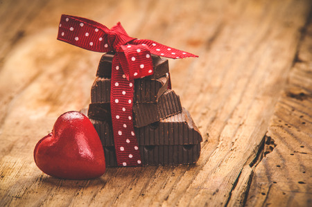 st: Chocolate with ribbon and heart on St. Valentine