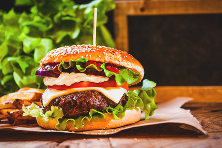 Juicy and fragrant hamburger with fries homemade copy space for your text. Фото со стока - 35382342