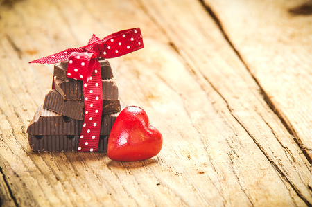 Chocolate with ribbon and heart on St. Valentine's day love. Standard-Bild