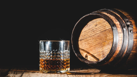 whisky: Strong alcohol on a wooden table and barrel