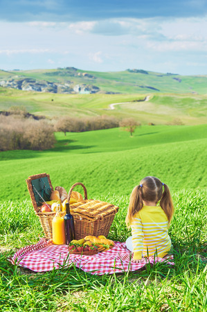 reversed: Little girl reversed back doing a picnic in the countryside of Tuscany.