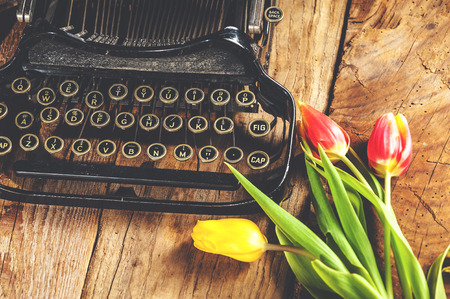 Flowers at the typewriter, writing a romantic letter.