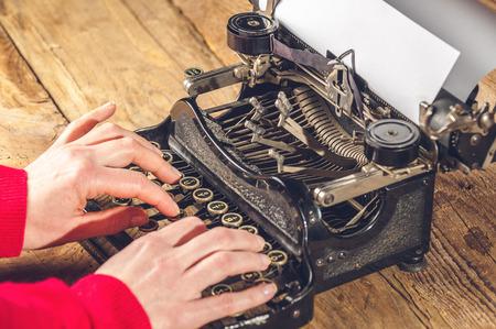 Hands secretary, writing on an old typewriter. photo