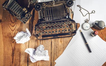 prescribed: Text prescribed on a vintage typewriter and watch timekeeper.