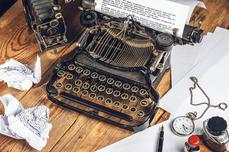 prescribed: Text prescribed on a vintage typewriter and watch timekeeper.