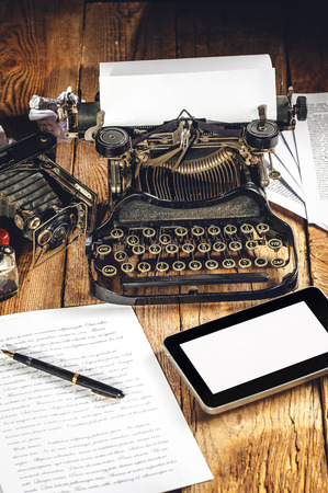 analog camera: Digital Tablet, analog machine, analog camera when creating a text to an article or study.