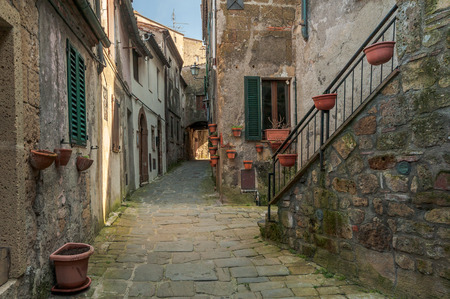 residential idyll: Solar ancient town and the streets of the beautiful Tuscany, Italy Stock Photo