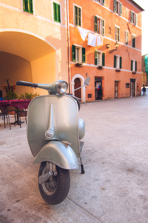 mode transport: Italian popular mode of transport scooter parked in the Tuscan town Stock Photo