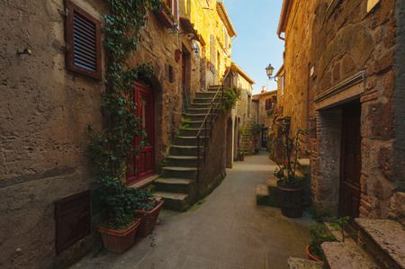 Italian old ancient alley in the medieval Tuscan town photo