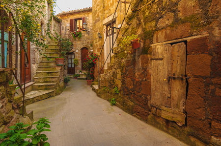 Italian old ancient alley in the medieval Tuscan town