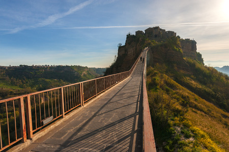 etruscan: Etruscan city located on the inaccessible hill, with the only way to reach the bridge, Civita di Bagnoregio, Lazio. Stock Photo