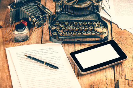 Digital Tablet, analog machine, analog camera when creating a text to an article or study. photo