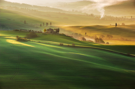 Beautiful Tuscan landscape with long shadows and mists