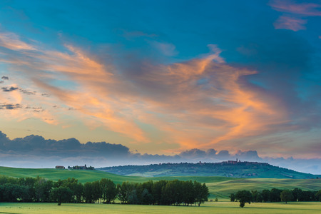 pienza: The medieval town of Pienza at colorful sunset Stock Photo