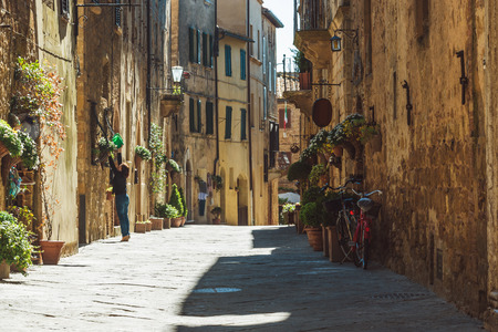 Beautiful colorful streets of the Tuscan town on a sunny day Фото со стока - 42029287