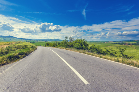 seson: The asphalt road in the summer of Tuscany