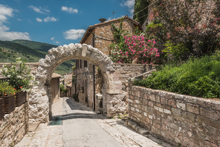 spello: Old rocky arch over the street in Spello, Umbria
