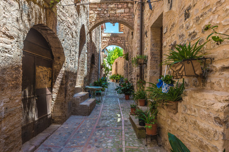 spello: Transitions and abbreviations under the arches in the Italian medieval town Stock Photo