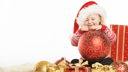 christmas atmosphere: Christmas atmosphere and beautiful smiling blond little girl