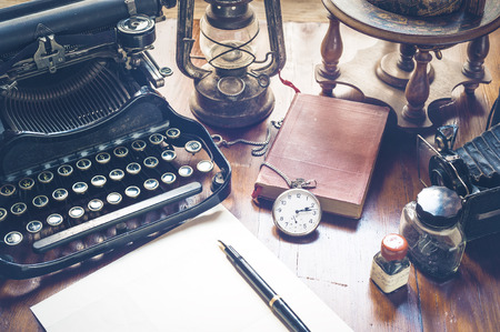 old items: Vintage items, camera, pen, globe, clock, typewriter on the old desk