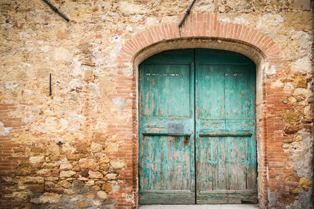 Doors and elements of the old Italian village in Tuscany Foto de archivo