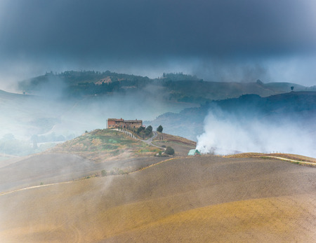 italy landscape: Beautiful foggy landscape in the middle sunrise. Italy, Tuscany.