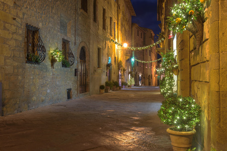 Beautiful street in the medieval village adorned in Christmas decorations, Pienza