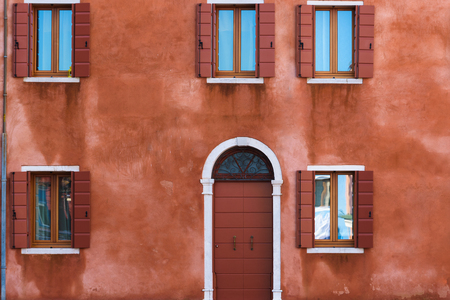 windows and doors: Colorful facades with doors and windows in Burano, Italy.