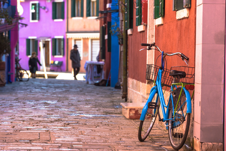 burano: Bicycle leaning colored house in Burano, Italy. Stock Photo