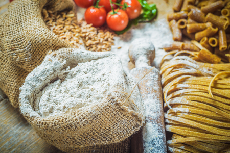 integral: Integral components of tagliatelle pasta ingredients and tomatoes. Stock Photo