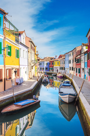 unusually: Unusually painted buildings, boats parked in the canals, the town of Burano. Stock Photo