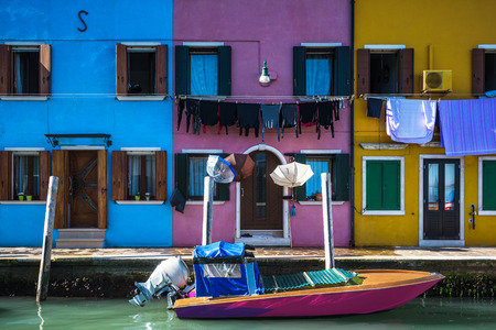unusually: Unusually colorful houses in an artistic medieval village of Burano, Italy. Stock Photo