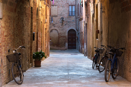 the tuscany: Rural bikes on the streets of the beautiful medieval town in Tuscany. Stock Photo