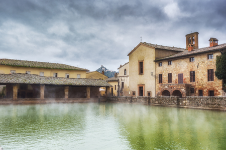 a bathing place: Small town famous for its hot water springs in Tuscany, Bagno Vignoni. Stock Photo