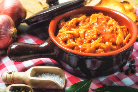 Tripe Florentine, typical Italian, Polish, French food. On a rustic table. Stock Photo