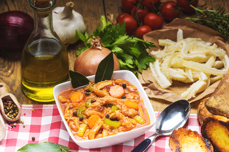 trippa: Tripe Florentine, typical Italian, Polish, French food. On a rustic table. Stock Photo