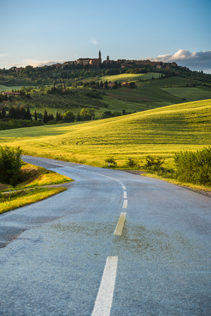 pienza: View of the town from way to Pienza at sunset