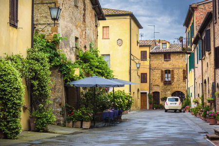 pienza: Flowery streets on a rainy spring day in a small magical village Pienza, Tuscany. Stock Photo