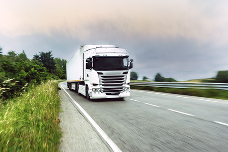 moving truck: Fast moving truck with a blurred way. Stock Photo