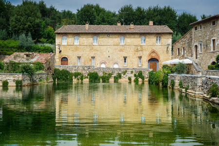 a bathing place: Old age looking medieval village with a natural spa in Tuscany.