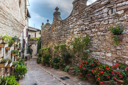 Surprising appearance of streets full of flowers in Spello, Umbria.