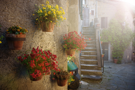 Spring streets of the old Tuscan town. Colorful flowers bloom and fragrant.