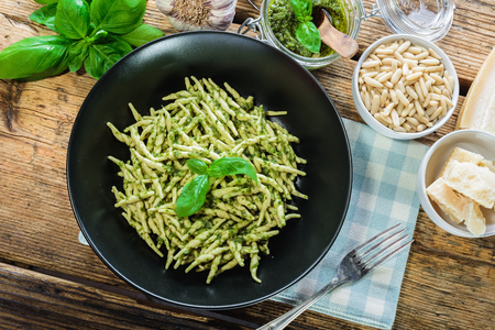 Trofie pasta with vegetarian sauce, pesto with pine nuts and basyli.