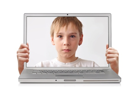 safety box: Young boy inside laptop, hands holding screen Stock Photo