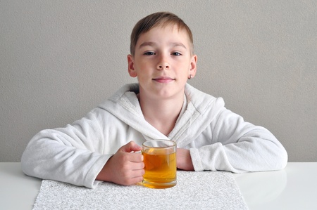 Have a nice tea! Boy with a cup of tea Stock Photo - 9515305