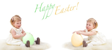 Two baby girls with easter eggs, isolated on white photo
