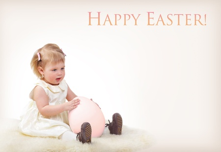 Cute baby girl with big easter egg, greeting card photo