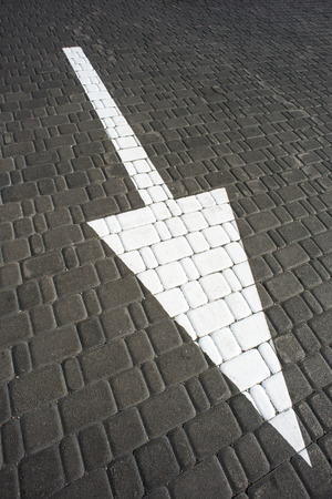Big white arrow on the road photo